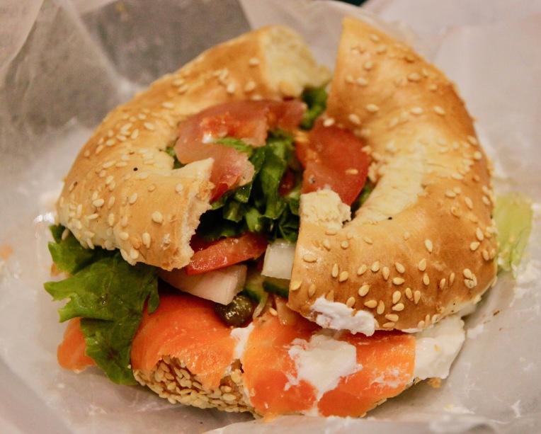 Photo by Benreis CC BY 3.0 via [Wikimedia](https://commons.wikimedia.org/wiki/File:Bagel_lox_sesame_seeds_St._Lawrence_Market.JPG)