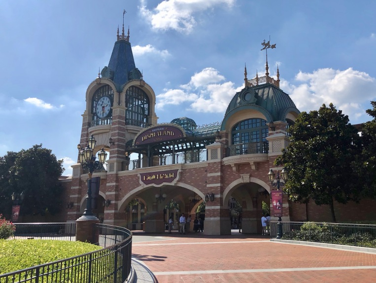 This building takes the place of the train stations in other Disneyland parks. Notice the Mickey Mouse clock on the tower.