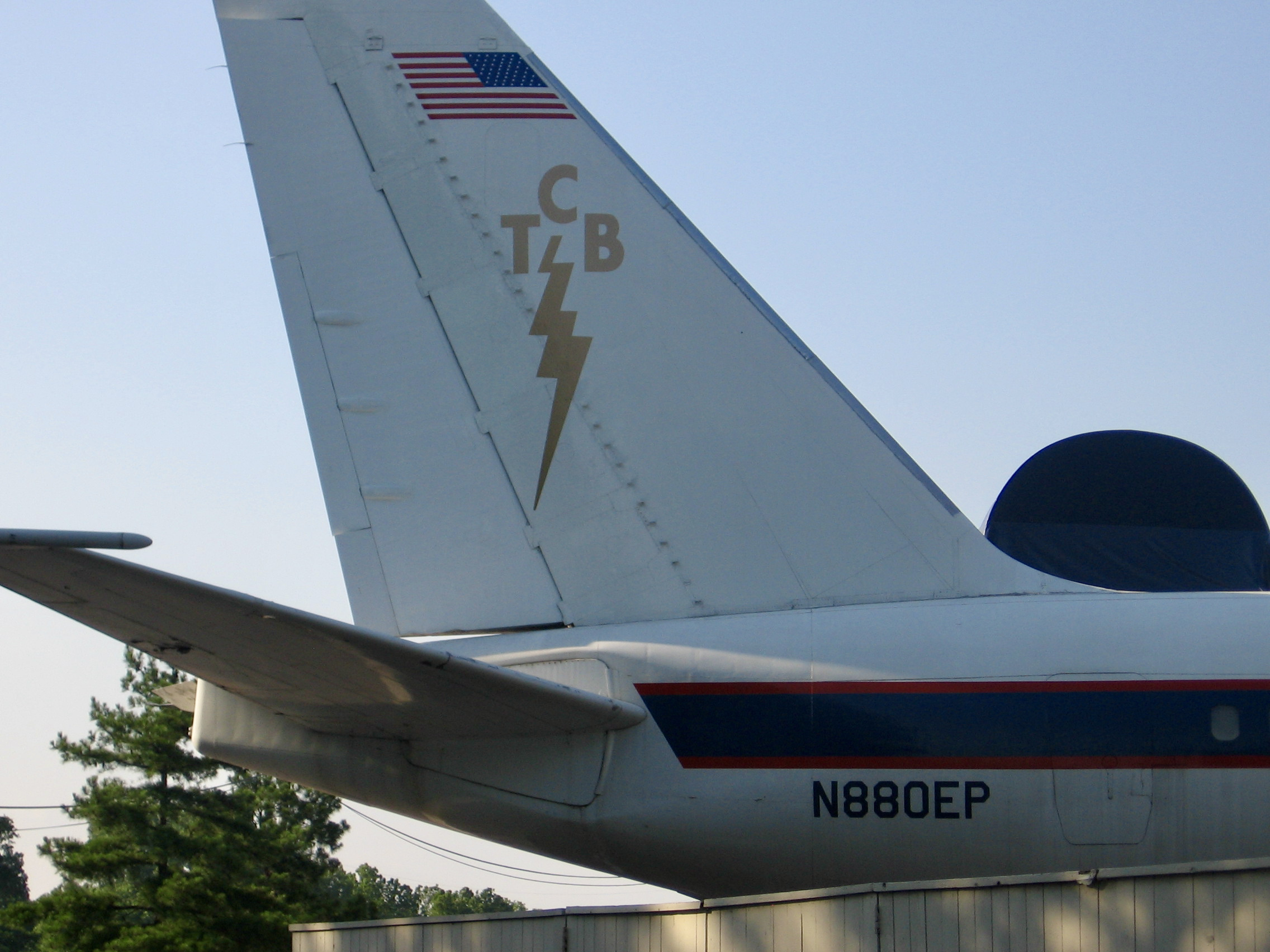 Tail of Elvis's jet, showing the TCB logo